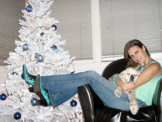 White tree with blue bulbs and wicked boots on Dogs, Dishes, and Decor.