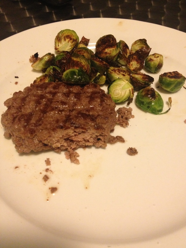 Overcooked burger with Brussels sprouts